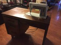 Free vintage stitching machine that was left in our