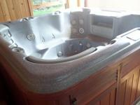 Free Sundance Optima Hot tub with lid. Over 10 years