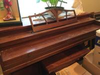 Upright piano that once belonged to grandmother.