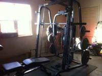 Free Weight Gym with many accessories and weights.
