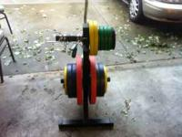 Almost new Free Weights and Stand. Sells for over $350