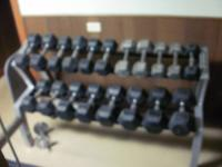 Over 1400lbs of free weights, bars, bench and rack
