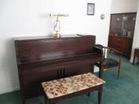 This Lester upright piano with piano bench was owned by