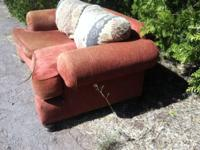 Free couch to good home. It's on the curb side. Just