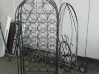 I HAVE A LOVELY METAL WINE RACK FOR SALE. IT IS FREE