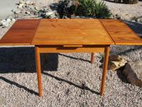 This is a vintage Danish Modern Teakwood dining table