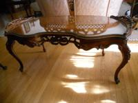 This is a wonderful antique inlaid coffee table. It is