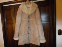 A real sheepskin and wool coat you can check out their