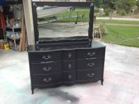 I have a French elegant black Bassett 9 drawer cabinet