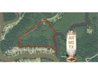 58.4 ac wooded recreational tract with camp & pond near