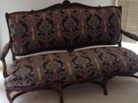 Beautiful antique French sofa with lots of wood trim.