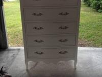 I have a French chic black Drexel 5 cabinet Tallboy.