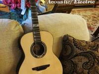 This is a Luna Grand Auditorium Guitar with SOLID