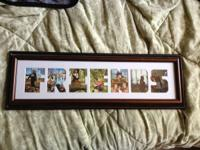 "Photo frame that spells the word ""Friends"". Can fit"