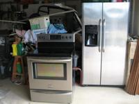 both are stainless steel (see pictures). refrigerator