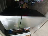 $350 OBO Brushed Nickel and Black fridge for sale. Less