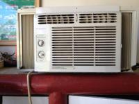 Frigidaire 5,000 BTU air conditioning unit glass device