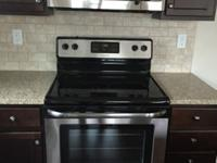 Frigidaire electric range with overhead microwave oven.