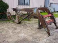 FRONT END LOADER FOR A FORD 4600 TRACTOR. NEED'S BUCKET