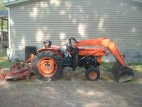 its a 1985 kabota tractor with a front end loader runs