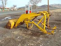 Front loader attachment for farm tractor, hydrolics