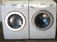 White maytag Neptune front loading washer and dryer.