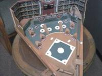 This is a handcrafted baseball pinball board game made