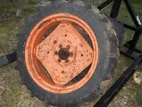 2 front tires and rims for kubota tractor 4x4, great