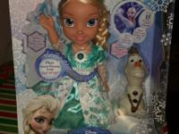 I'm selling a new and unopened Frozen Snow Glow Elsa