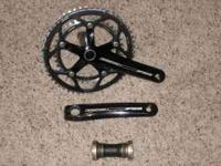 "This is a new crankset that was a ""take-off"" from a new"