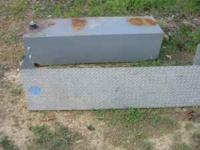 We are selling a fuel tank it has a metal cover to go