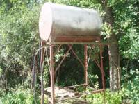Fuel tank, 300 gallon, on 7' stand. Call  Location: