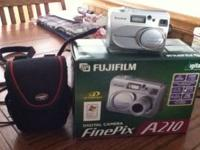 "Fujifilm digital camera. 3.2 Megapixels 1.5""screen."