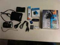 For sale is a Fuji Finepix XP10 camera and accessories.