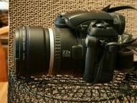 10X Optical Zoom, uses 4 -AA batteries, also has carry
