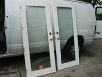 2 dual pane full glass panel doors 76 5/8 x 31 1/2.