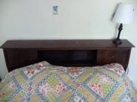 Dark wood full size bed frame $85. The headboard is