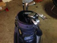 Full set of clubs with skill bag lots of pockets. Set