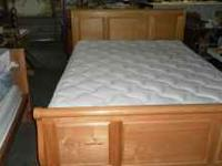 Full size bed with wood frame and head board and foot