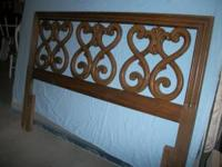Full size headboard. Scroll pattern on inside. Dark