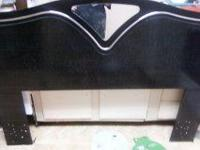 It is a full size headboard. Very pretty. Has a small
