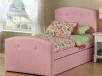 This Full Pink Upholstered Bed is a lovely addition to