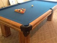 For sale a full size 8' regulation pool table with a