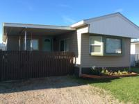 Fully furnished modern-looking mobile home. Located in