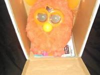 New orangish/red furby, lightly played with a few
