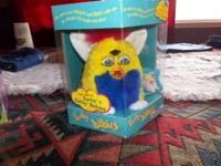 i have three furby for sale one green unopenend 1 gray