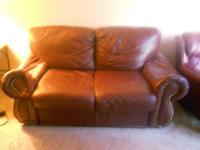 Very comfy leather love seat and armchair, can be sold