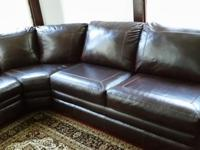 it is dark black, comfortable leather living room,