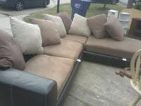 1 sofa is a corner L shape tan and black very elegant1