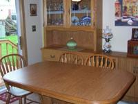 Solid Oak double pedistal dining room table and 4